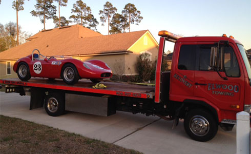Towing Red Car